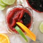 Frozen Haskap Berry Orange Margarita with limes|
