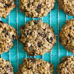 gluten free vegan oat energizing superfood cookies for new mamas on wire rack with teal blue towel