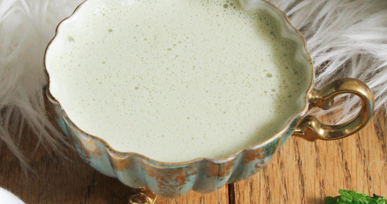 noorishmint elixir with holy basil tea, horsetail tea, spirulina, honey, spearmint, vanilla in an antique tea cup